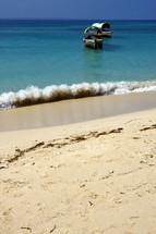 beach and boat in prison island Tanzania Zanzibar