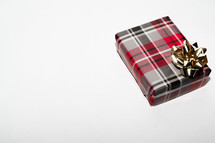 a wrapped Christmas gift on a white background