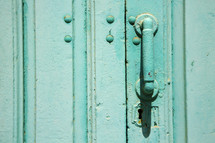 door handle on a turquoise door