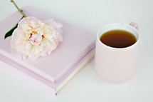 pink flower on pink notebooks and coffee