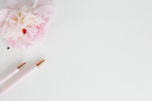 pink flower and pens