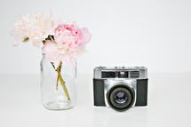 vintage camera and flowers in a vase