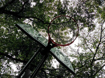looking up at a basketball hoop