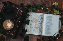 Open bible with fairy lights