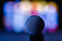Colored lights behind a microphone.