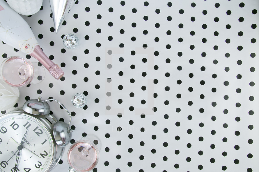 champagne bottle, alarm clock, polka dots, black and white, pink, new years