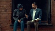 Christian Witnessing to Man on Street