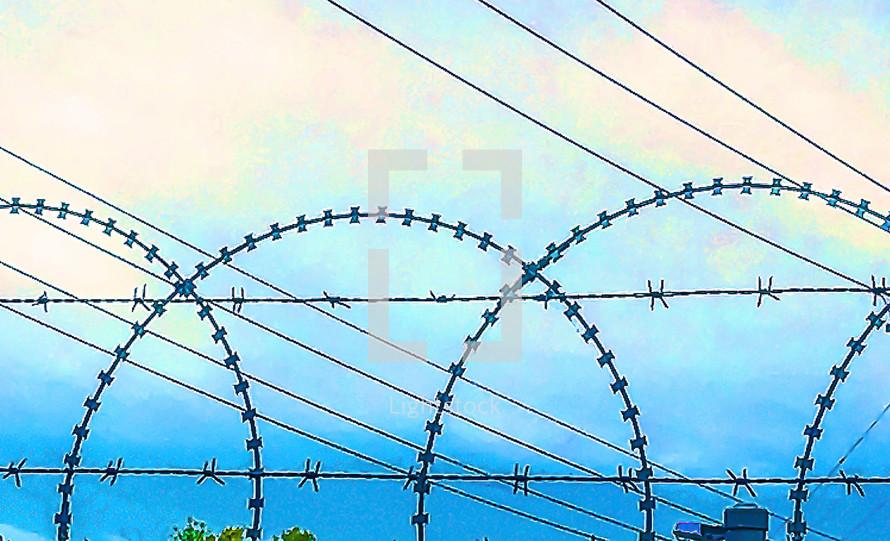 Razor wire and blue sky