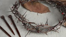 crown of thorns, three nails, and shroud