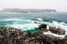ocean crashing into rocks