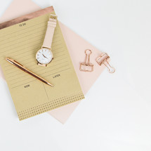 to do list, pen, candle, pink, gold, notepad, watch, pink, clips, white background