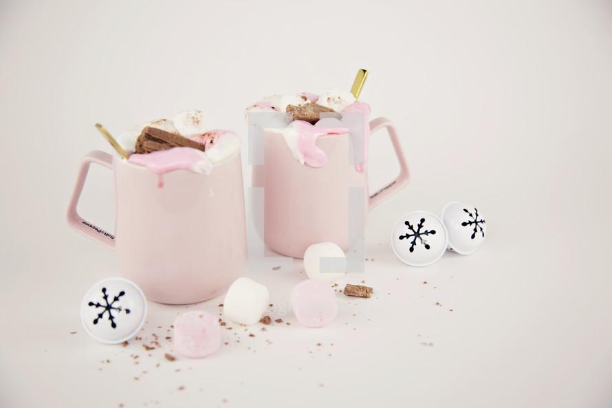 pink mugs and Christmas bells