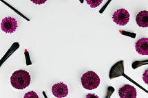 lipstick and makeup brushes and purple mums