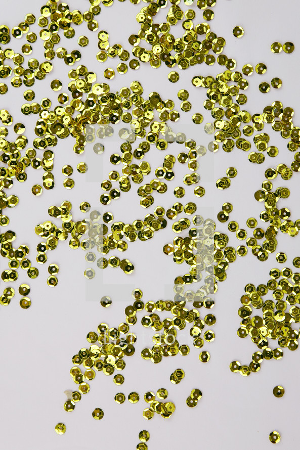 gold sequins on a white background