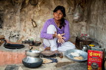 a woman cooking in India