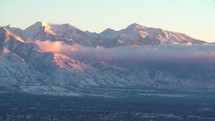 clouds moving over the mountains surrounding Salt Lake City
