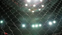 MMA - Cage Close Up with shining lights