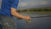 man casting a fishing pole
