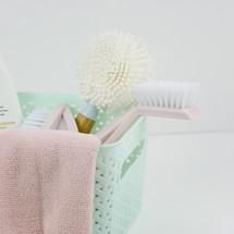 mint basket, pink towel, brushes