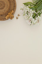 flowers, basket and earrings on a white background