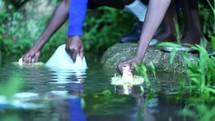 filling water jugs in Kenya