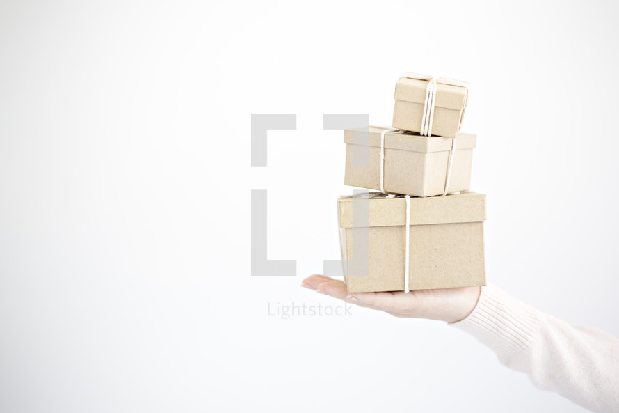 a woman holding gift boxes