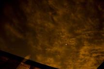 full moon in a cloudy night sky