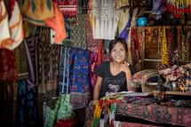 vendor selling fabrics in a market