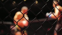 MMA - Cage Close Up with Fighters Fighting In The Background