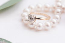 engagement ring and pearls