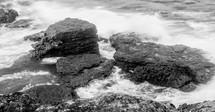 tide washing over rocks