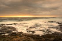 Sunrise on the horizon at Merry Beach.