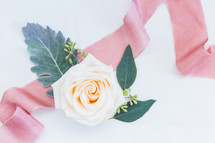 rose and pink ribbon on a wedding cake