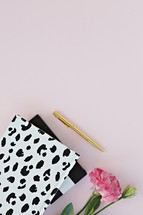 dalmatian spotted notebook, pink carnation, and gold pen