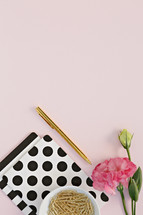 polka dot notebook, pink carnation, gold paperclips