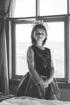 a little girl dressed like a princess