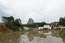 muddy waters and village in Indonesia