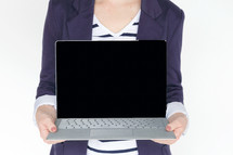 a woman holding a laptop computer