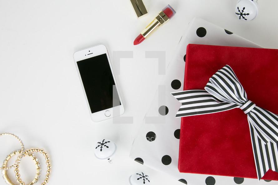 lipstick, earrings, bracelets, nail polish, makeup, presents, iPhone, phone, white background