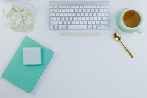 home office desk with keyboard and cup of tea