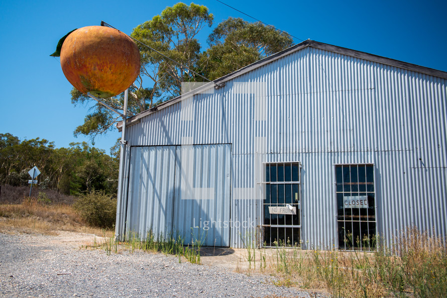 metal shed and peach logo