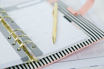 a pen on a planner