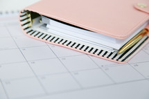 pen and planner on a calendar