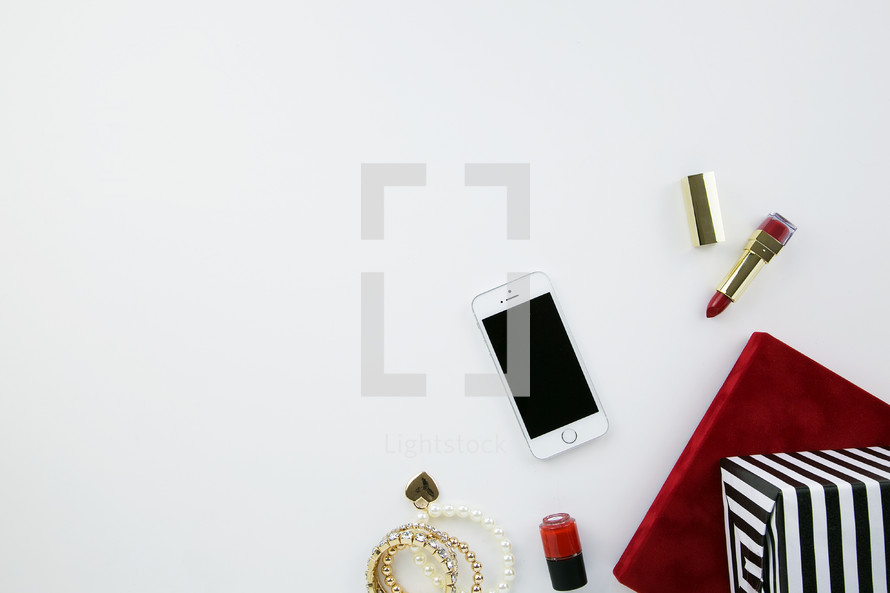lipstick, earrings, bracelets, nail polish, makeup, presents, iPhone, phone, white background