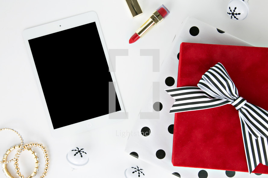 iPad, tablet, electronics, bowl, bells, lipstick, earrings, bracelets, makeup, presents,  polka dots, gold, red, black, white, white background