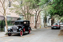 vintage automobile in front of a historic home