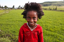 Young girl standing in a field