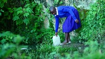 filling a water jug in Kenya