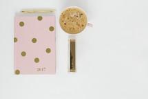 pink and gold polka dot 2017 planner, pen, stapler, and latte