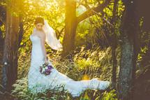 portrait of a bride holding a purple bouquet